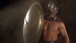 Spartan soldier holds shield at blast