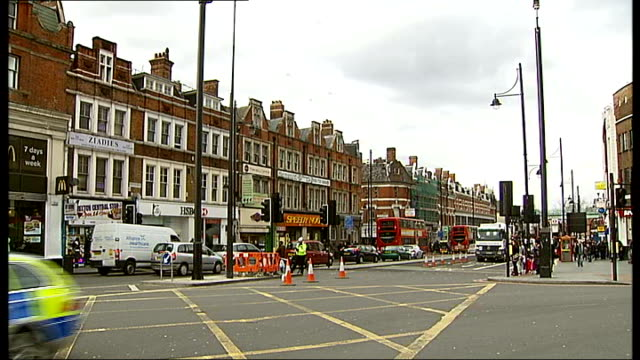 spate of stabbing attacks in south london; 2 - 3.3.12 england: south london: brixton: ext gv brixton high street gv people to and fro along street... - 刺傷事件点の映像素材/bロール