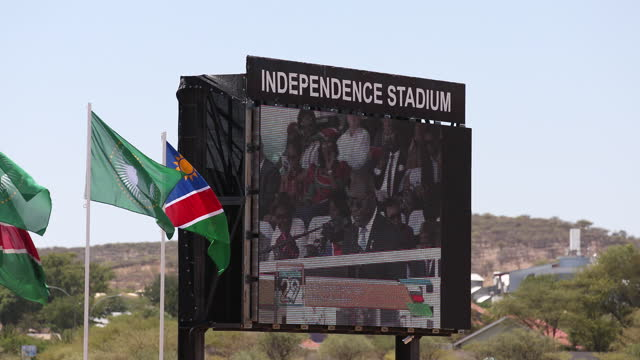 speach is broadcasted on a big screen during the celebration of the 29th anniversary of liberation of namibia, at the independence stadium, in... - 映像技法点の映像素材/bロール