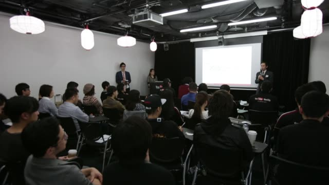 Speaker addresses video creators at a seminar as part of the YouTube Partner Program at Google Inc's YouTube Space studio in Tokyo Another speaker...