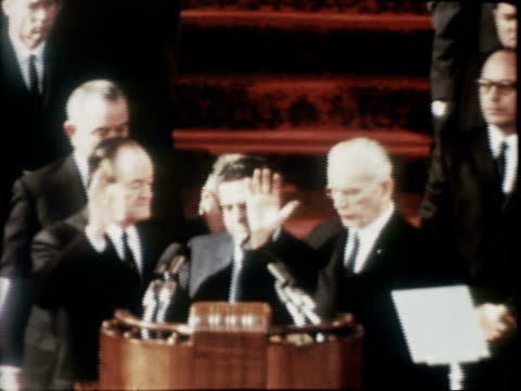 Speaker of the House JOHN MCCORMACK administering Vice Presidential Oath of Office to HUBERT HUMPHREY at outset Hubert Humphrey shakes hands with...
