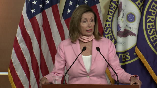 """speaker of the house nancy pelosi remarks on the latest in coronavirus relief negotiations and says """"let's be prayerful"""" during a press briefing. - healthcare and medicine or illness or food and drink or fitness or exercise or wellbeing stock videos & royalty-free footage"""