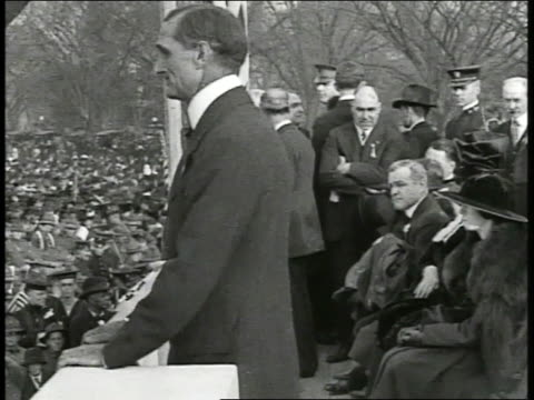Speaker standing in podium w/ seats at Liberty Bond rally crowd below VS Crowd of people at rally MS Douglas Fairbanks Sr Charlie Chaplin Mary...