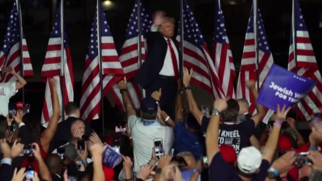 """speaking at his first campaign rally since contracting covid-19, us president donald trump says he feels """"so powerful,"""" celebrating his apparent... - contracting stock videos & royalty-free footage"""