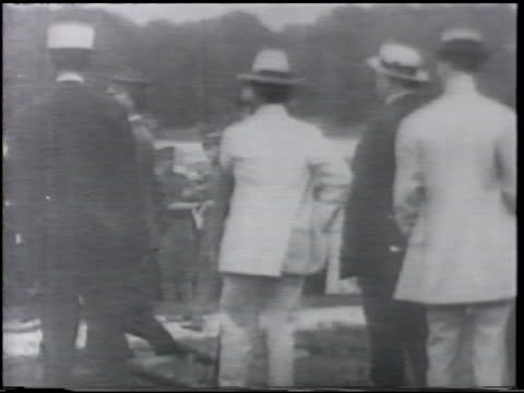 stockvideo's en b-roll-footage met specatators men getting 'wright flyer' ready out of hangar photo lieutenant benjamin foulois w/ orville wright ws lt foulois orville in biplane [vo... - 1900 1909