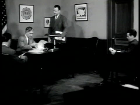 special agent in charge at desk talking w/ other agents agents talking about nazi member 'auguste baumeyer' nyc - 1942 stock videos and b-roll footage
