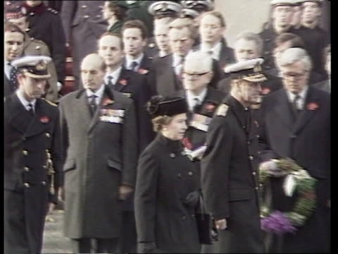 special branch tx 111184 itn remembrance day service whitehall cenotaph la security camera attached to balcony man with binoculars looking down... - remembrance day stock videos and b-roll footage