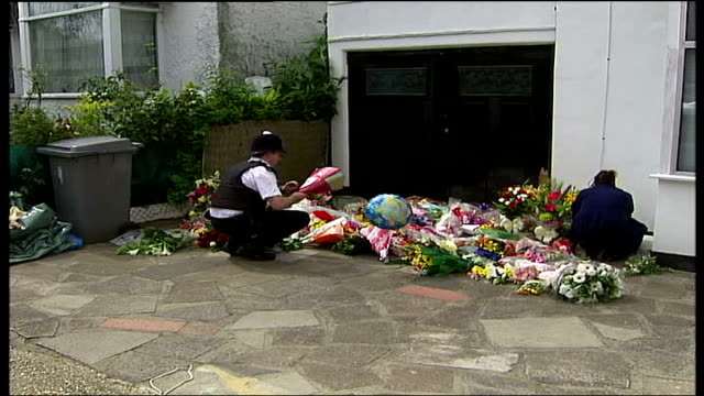 special constable nisha patel nasri murder husband appeals for information england london ext back view of police officer laying floral tribute in... - house husband stock videos & royalty-free footage