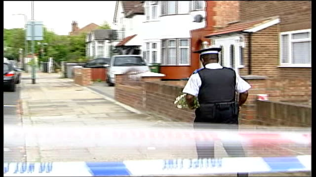special constable stabbed to death england north london wembley ext back view police officer carrying flowers along at scene where special constable... - rear view stock videos & royalty-free footage