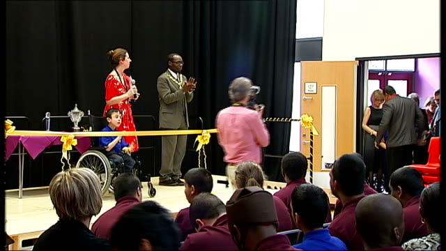 stockvideo's en b-roll-footage met special educational needs 'village school' opened in brent derek derenalagi applauded by audience as onto stage at opening ceremony - afhankelijkheid