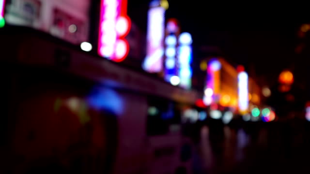 special effect view of visitors wander at the nanjing road shopping street in the evening, shanghai, china - special effect stock videos & royalty-free footage