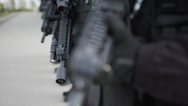 special forces standing in line and hold firearm - weaponry stock videos & royalty-free footage