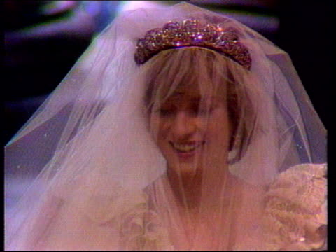 Funeral of Princess Diana 0900 1000 Excerpts from intvws with Diana played over shots Montage of images of Diana Diana walking down street avoiding...