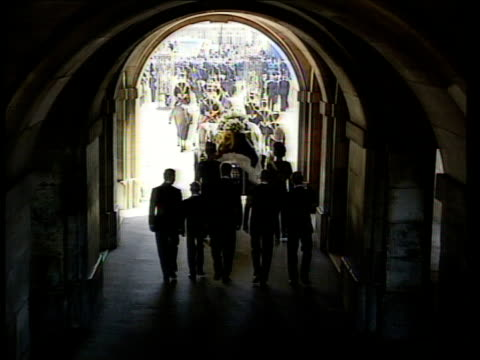 funeral of princess diana: 10.00 - 11.00; almost 10.40 good shot princes, spencer & duke along following guards memorial in b/g as procession towards... - funeral stock videos & royalty-free footage
