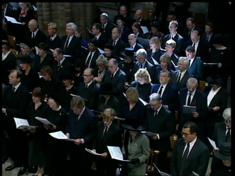 """funeral of princess diana: 11.00 - 12.00; 1113 all sing """"i vow to thee my country"""" pan across congregation 1114 people in crowd outside some singing... - funeral stock videos & royalty-free footage"""