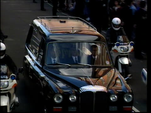 funeral of princess diana 1200 1300 1227 hearse and motorcycle outriders along park lane with car along behind hearse along with police motorcyclists... - hearse stock videos & royalty-free footage