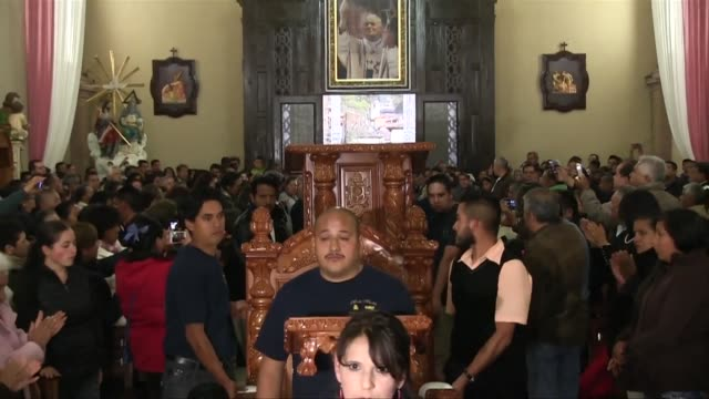 special furniture has been carved signs are going up around town and construction is under way on the venustiano carranza stadium where the pope will... - morelia video stock e b–roll