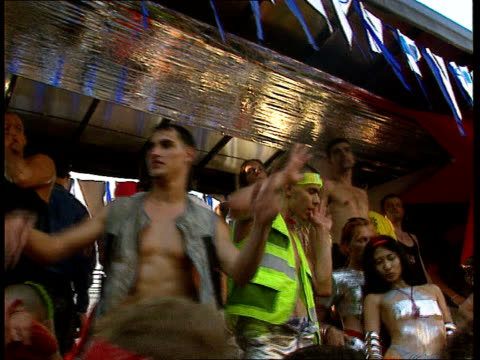special look at rave culture in europe; itn tgv ravers watching floats ravers dancing on british float side ditto l-r to ravers on ground dancing - cultures stock videos & royalty-free footage