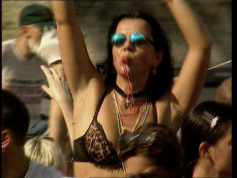 special look at rave culture in europe itn ravers dancing cms female raver in bikini shades on ms two female ravers dancing pull lms female ravers... - bikini top stock videos & royalty-free footage