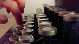 Special macro dolly shot hovering over old typewriter keys with male hand typing