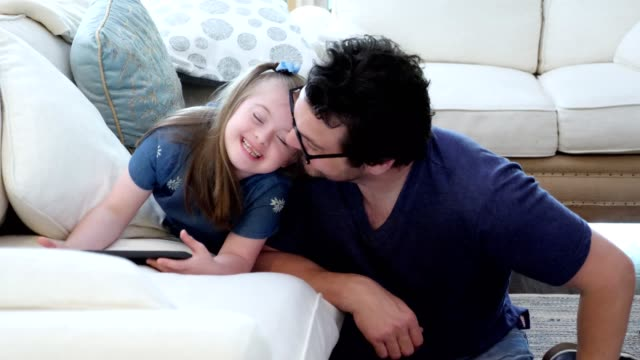 special needs girl and her dad spending time together - salute mentale video stock e b–roll