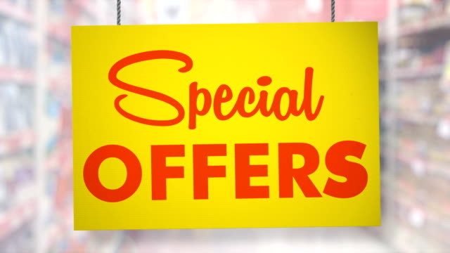 special offers sign hanging from ropes. luma matte included so you can put your own background. - price tag stock videos & royalty-free footage