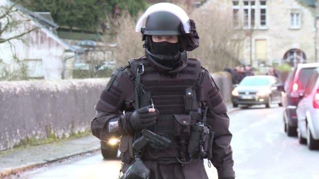 special police forces search houses in the french village of corcy about 80 kilometres north of paris near where the main charlie hebdo shooting... - materiale cartaceo video stock e b–roll