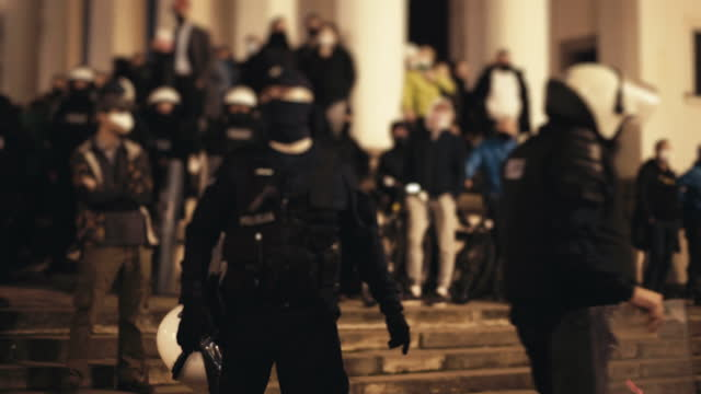 special police forces with shields marching along striking people - armed police forces stock videos & royalty-free footage