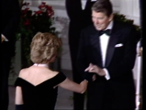 prince and princess of wales in washington ; 9.11.85 usa: washington dc: ext at night white house as reagans in evening dress wait for couple to... - princess stock videos & royalty-free footage