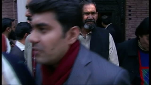 special report on imran khan young men next to motorbikes on city street birds wheeling above telephone wires and neon signs najam sethi interview... - lahore stock videos and b-roll footage