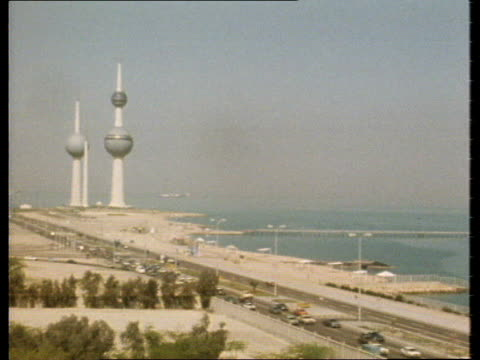 royal tour of the gulf:; kuwait: kuwait city: ext high angle view coastline and kuwait towers in b/g - angle stock videos & royalty-free footage