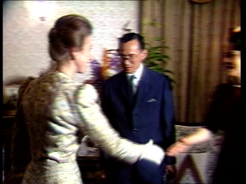 the princess royal in south east asia:; day 3 thailand: bangkok: ext tgv bangkok city tgv ditto ext men doing exercises in park as accompanying... - sitting stock videos & royalty-free footage