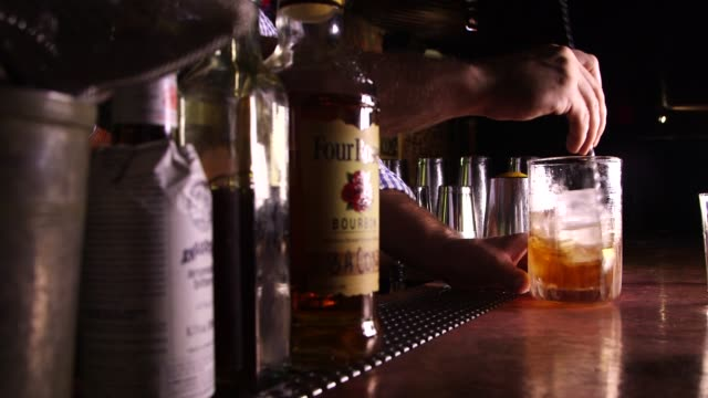 a speciality cocktail is mixed at please dont tell in new york ny us on august 18 shots close ups of a bartender mixing a cocktail close up of a... - cooking utensil stock videos & royalty-free footage