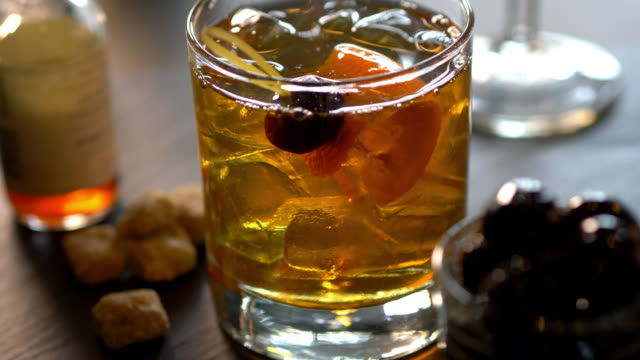 speciality prohibition style cocktail in cut rocks glass - scotch whiskey stock videos and b-roll footage