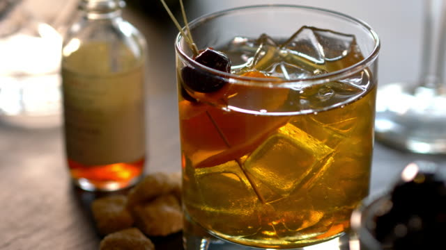 speciality prohibition style cocktail in cut rocks glass - scotch whiskey stock videos & royalty-free footage