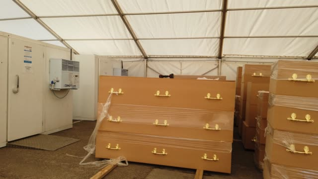 a specially trained volunteers works at the temporary mortuary erected in the car park of central jamia mosque ghamkol sharif during the coronaviurs... - spirituality stock videos & royalty-free footage