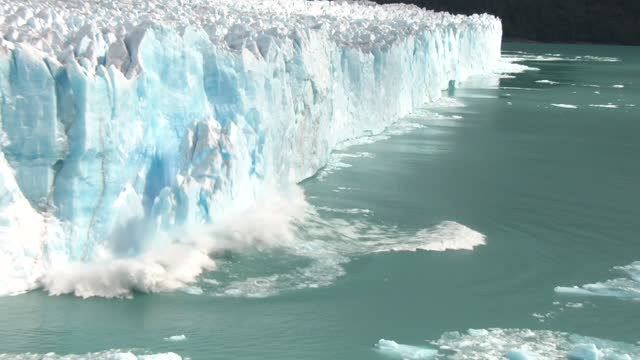 spectacular capture of a large iceberg breaking off the glacier 'perito moreno' on march 29, 2020 in the los glaciares national park, santa cruz... - breaking stock videos & royalty-free footage