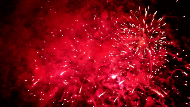 Spectacular closeup of red and white fireworks