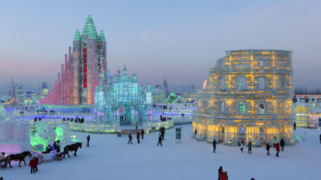 spectacular illuminated ice sculptures at the harbin ice and snow festival in heilongjiang province, harbin, china - snow festival stock videos & royalty-free footage