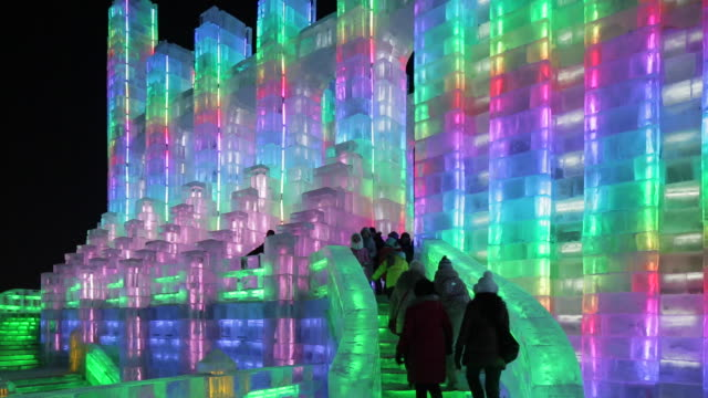 spectacular illuminated ice sculptures at the harbin ice and snow festival in heilongjiang province, harbin, china - ghiaccio video stock e b–roll