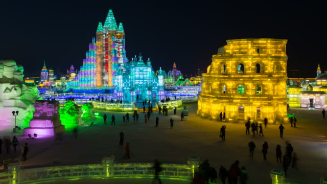 spectacular illuminated ice sculptures at the harbin ice and snow festival in heilongjiang province, harbin, china - time lapse - snow festival stock videos & royalty-free footage