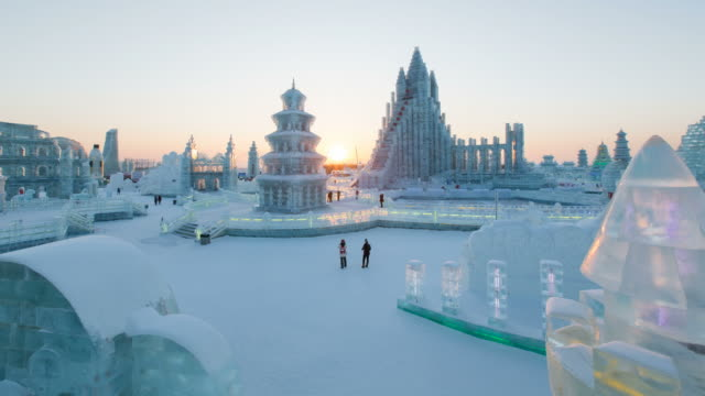 spectacular illuminated ice sculptures at the harbin ice and snow festival in heilongjiang province, harbin, china - time lapse - schneefestival stock-videos und b-roll-filmmaterial
