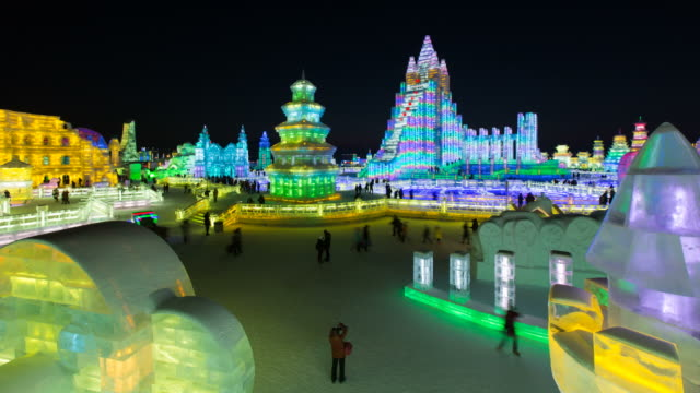 Spectacular illuminated ice sculptures at the Harbin Ice and Snow Festival in Heilongjiang Province, Harbin, China - Time lapse