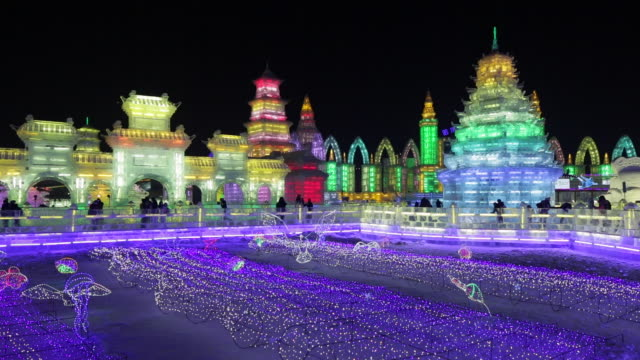 spectacular illuminated ice sculptures at the harbin ice and snow festival in heilongjiang province, harbin,  china - ghiacciato video stock e b–roll