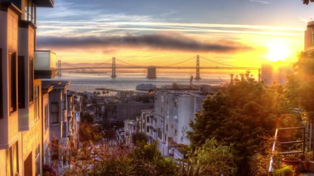 spectacular san francisco sunrise - san francisco california stock videos & royalty-free footage