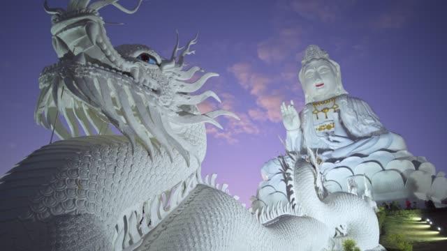 spectacular wat huay pla kang temple (big buddha) at dusk, chiang rai, thailand, southeast asia, asia - animal representation stock videos & royalty-free footage