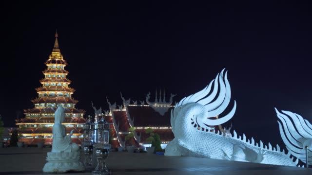 spectacular wat huay pla kang temple (big buddha) at night, chiang rai, thailand, southeast asia, asia - animal representation stock videos & royalty-free footage
