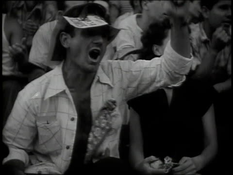 montage spectators and fans shouting waving and cheering at ebbets field / new york new york united states - ebbets field video stock e b–roll