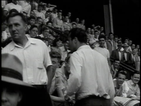 spectators and fans shouting, waving, and cheering at ebbets field / new york, new york, united states - anno 1947 video stock e b–roll