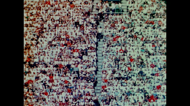 1958 spectators at a massive american football game - 1958 stock videos & royalty-free footage